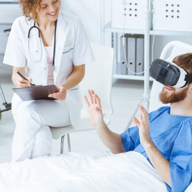 Young man in VR gesticulating during therapy in hospital